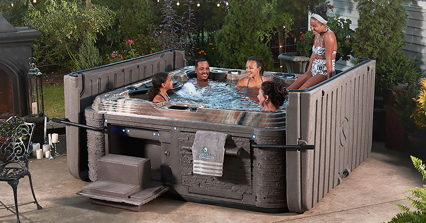 Family enjoying a Strong Spas hot tub