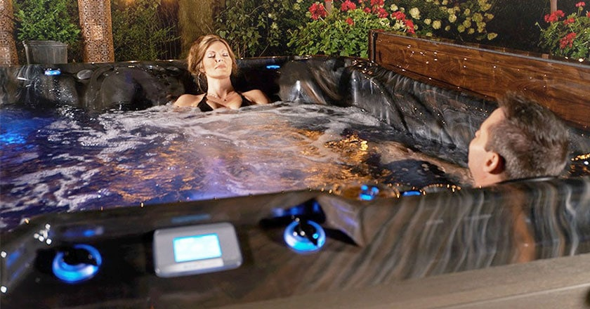 Woman and Man enjoying their Strong Spas hot tub
