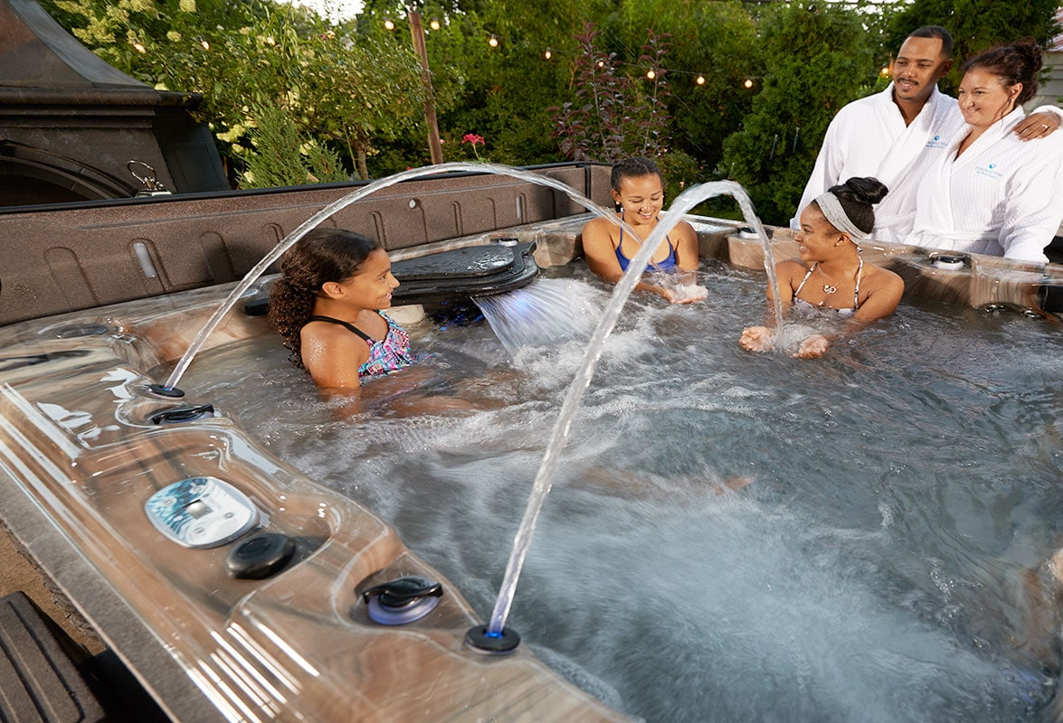 Young Family Enjoying Strong Spas Tub