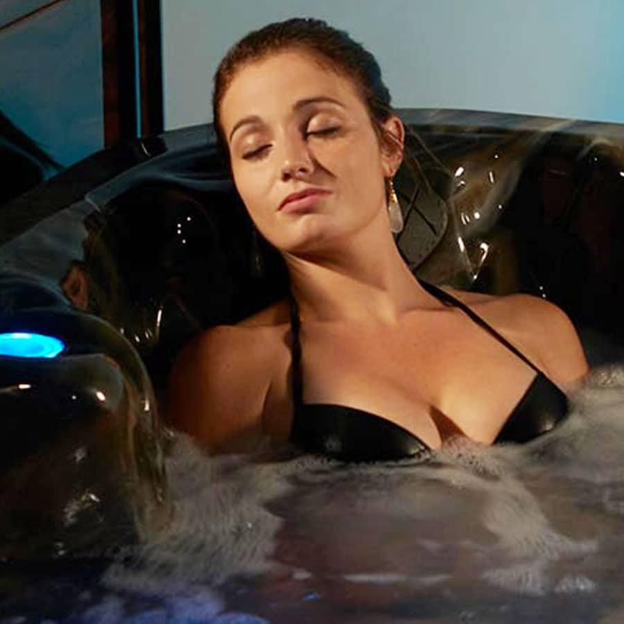 Woman In Bikini In The Tub