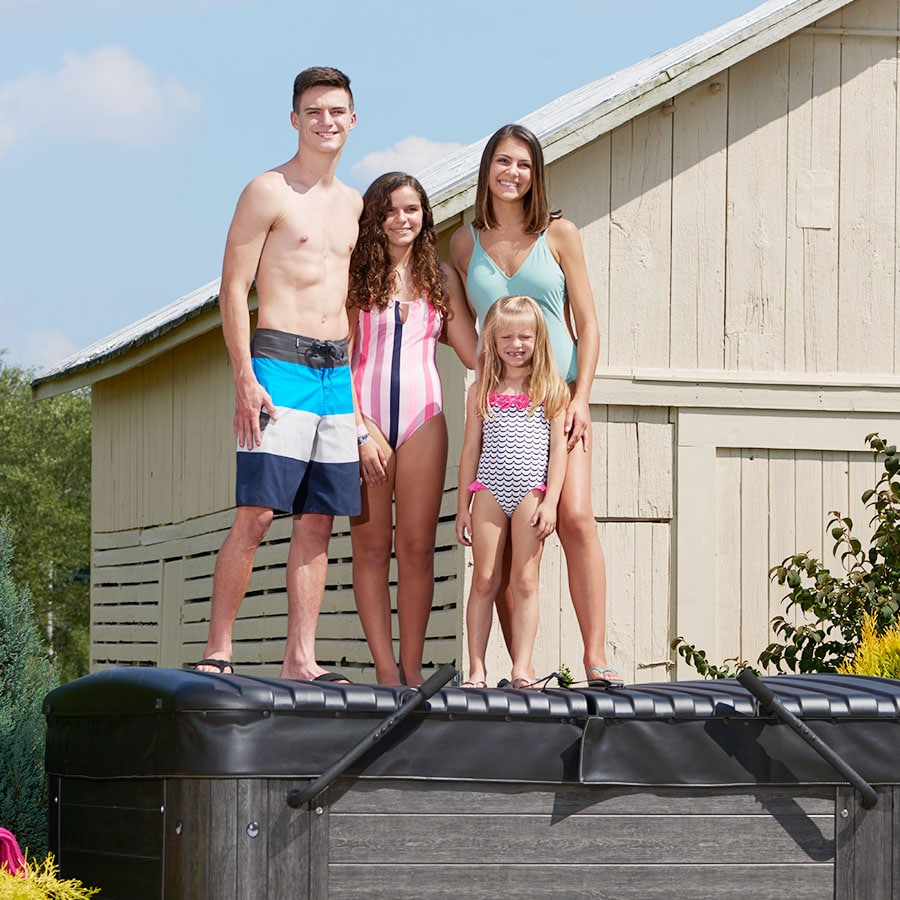 Happy Family Standing On Hot Tub