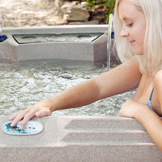 Woman Changing Tub Controls