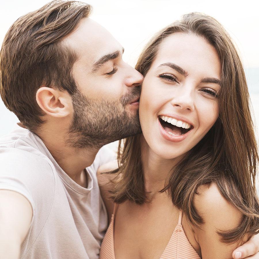 Man Kissing Girlfriend On The Cheek
