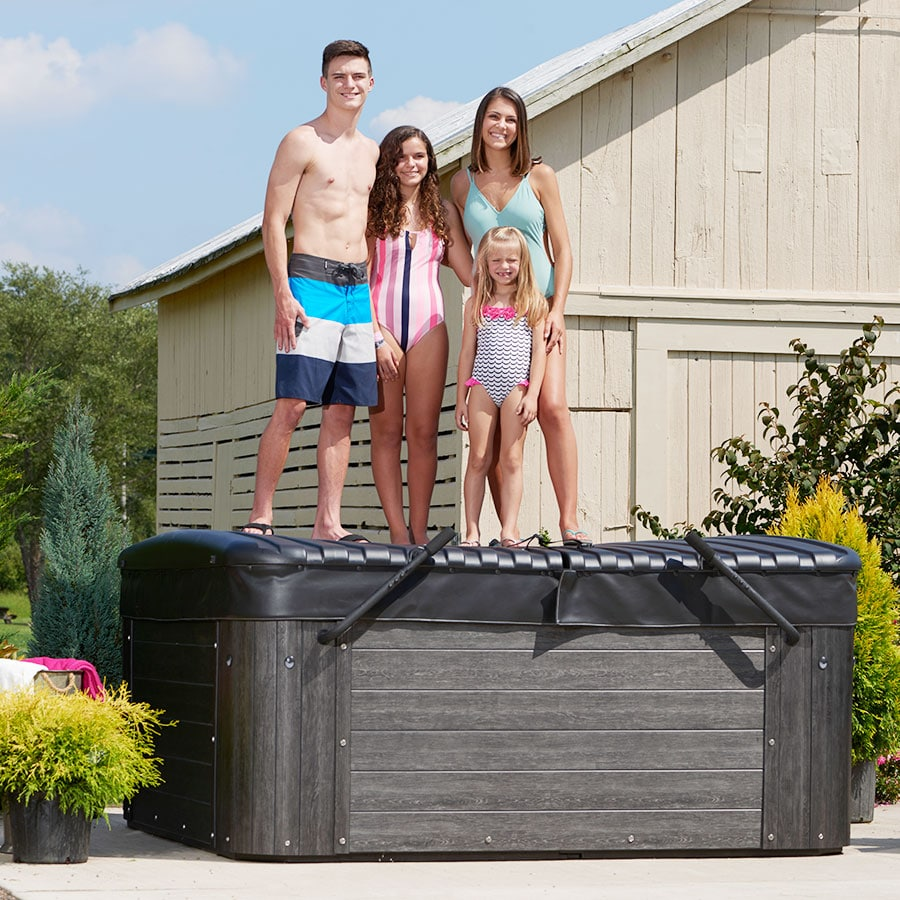 Family Standing On Top Of Hot Tub