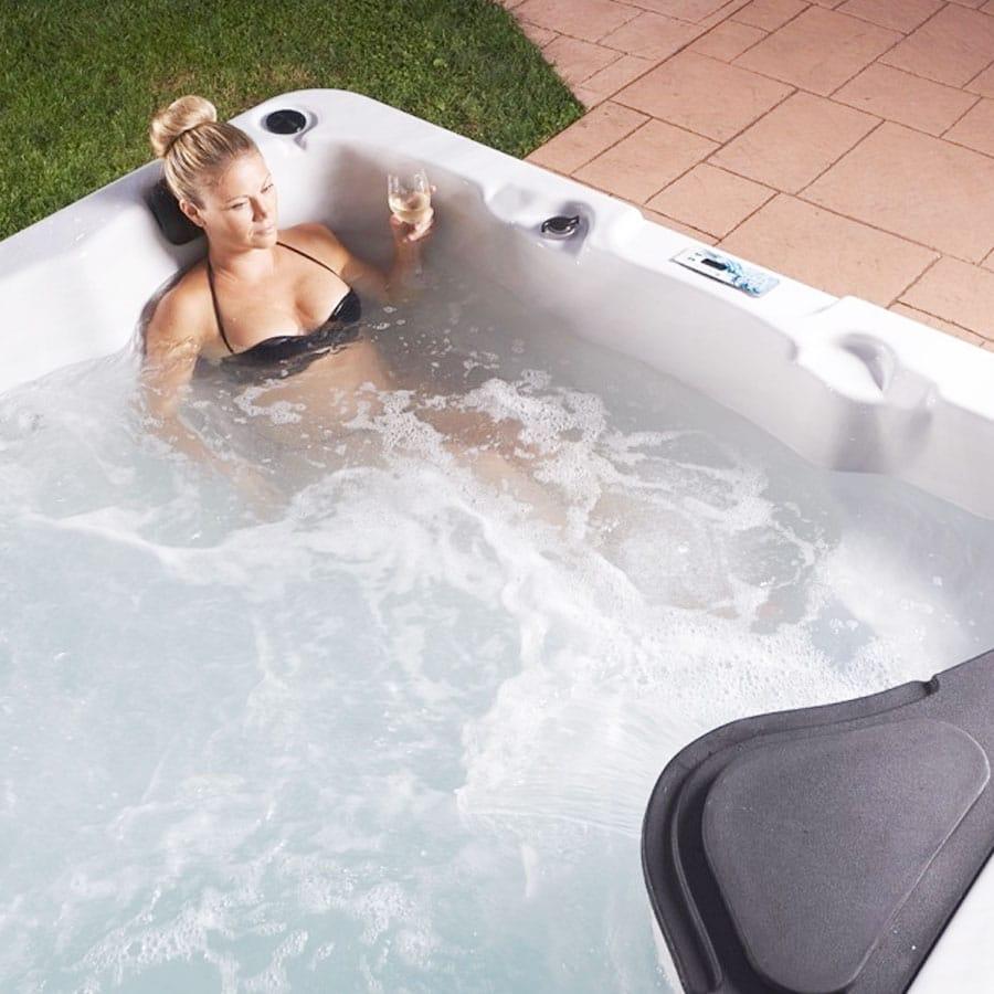 Blonde Female Enjoying Strong Spas Tub