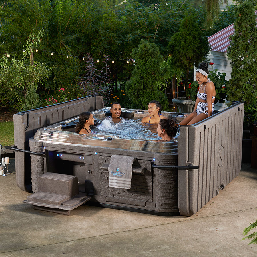 Family Keeping Safe Inside A Hot Tub