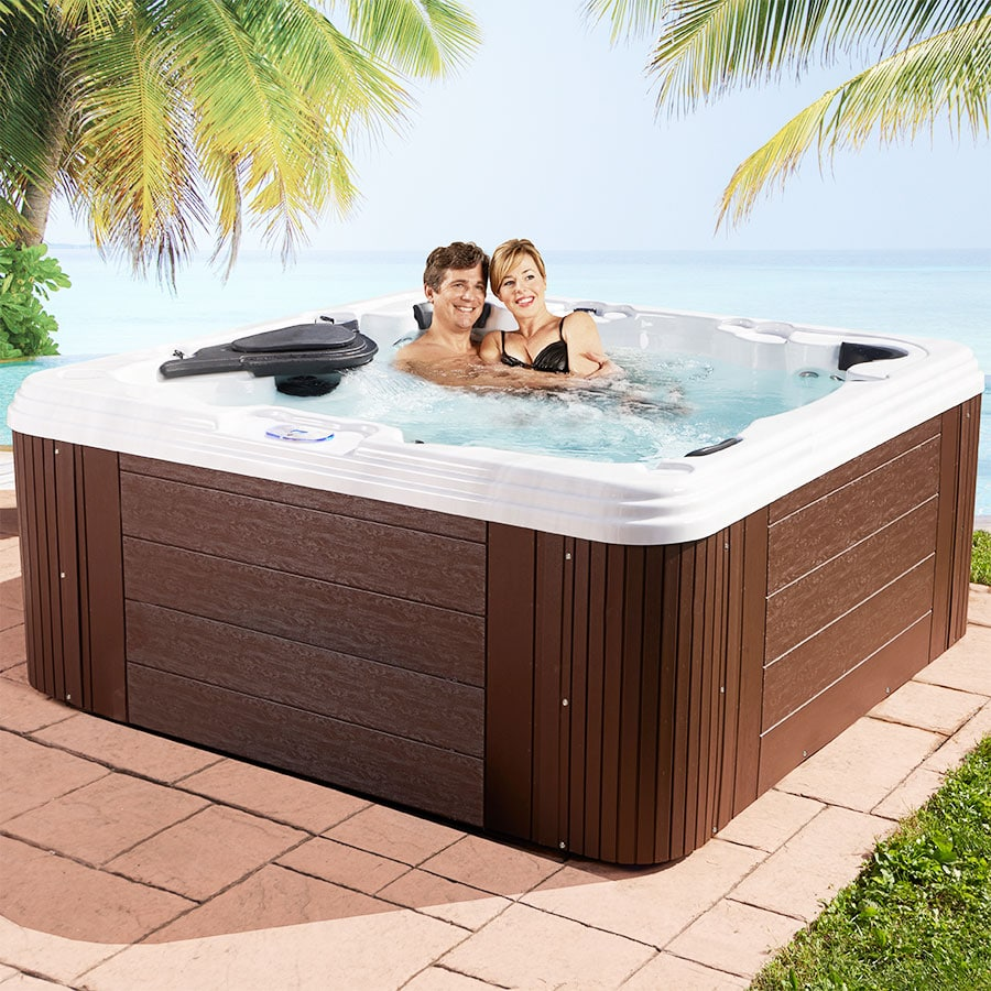 Couple In Hot Tub On Vacation